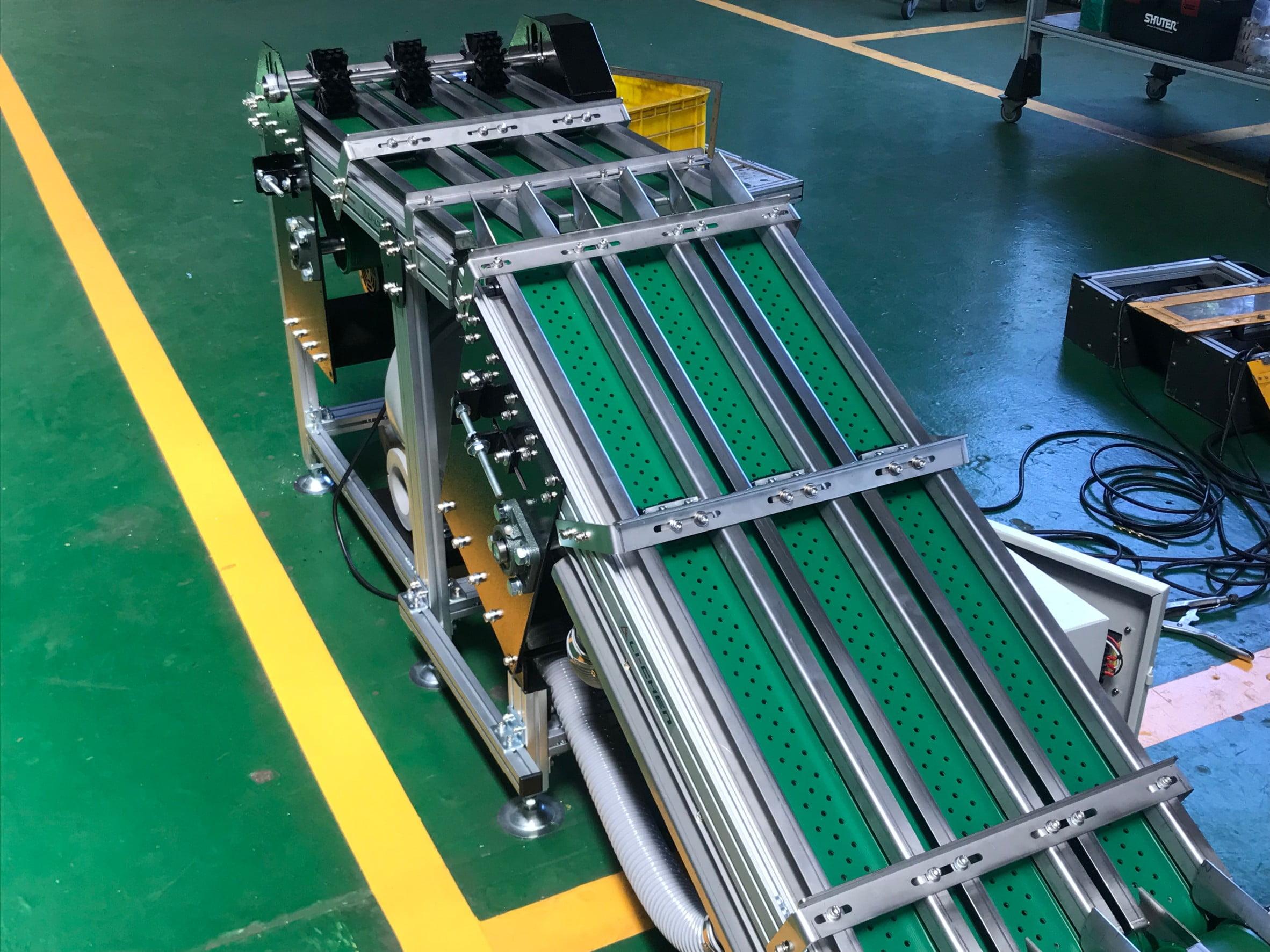 AAluminum Extruded Belt shunt Suction Conveyor -Lichen Conveyor Equipment Co., Ltd.